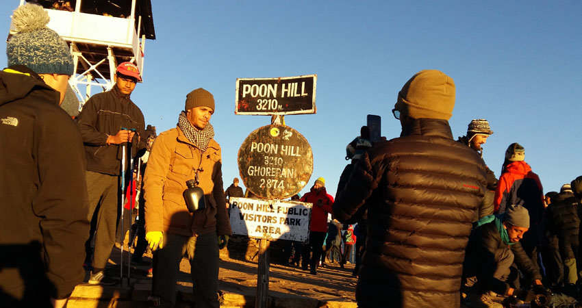 Poonhill with the sign board